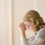 young-woman-praying-940299-tablet